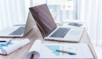 financial-charts-table-with-laptop_1232-2736