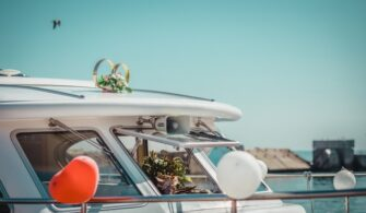motorboat-yacht-decorated-with-flowers-balloons-wedding_370806-135